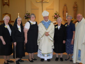 Jubilarians with Bishop Robert and Father Kevin.