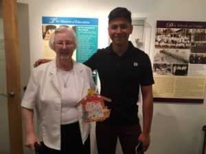 Sister Rosemary Boyd with Jesus Hernandez.  Sister had kept a craft that Jesus made when he was in elementary school and they both enjoyed remembering making it together.